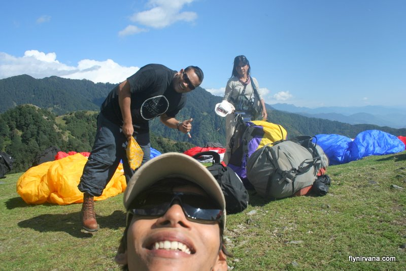Three happy paraglider pilots in the Himalayas