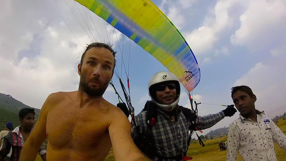 Dinesh holds his wing up for Emil's camera - para fun at Nirvana Paragliding Club